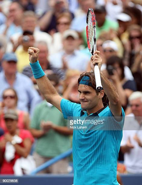 Roger Federer of Switzerland celebrates defeating Novak Djokovic of Serbia in the Singles Final during day seven of the Western Southern Financial...