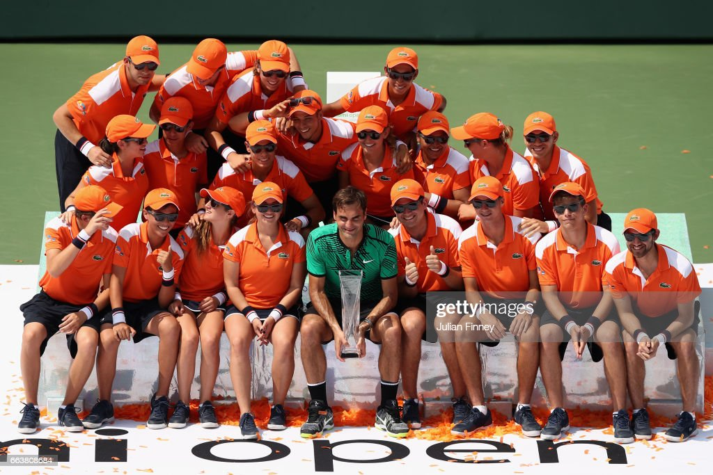 Roger Federer of Switzerland celebrates defeating Rafael Nadal of Spain with the ball boys and girls after the final at Crandon Park Tennis Center on April 2, 2017 in Key Biscayne, Florida.