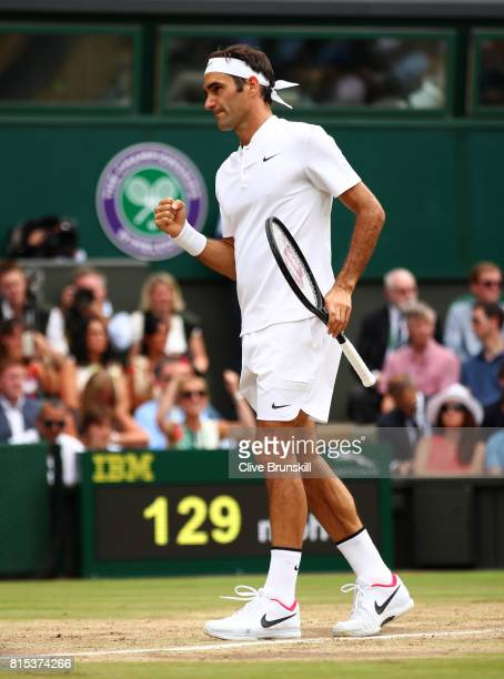 Roger Federer of Switzerland celebrates during the Gentlemen's Singles final against Marin Cilic of Croatia on day thirteen of the Wimbledon Lawn...