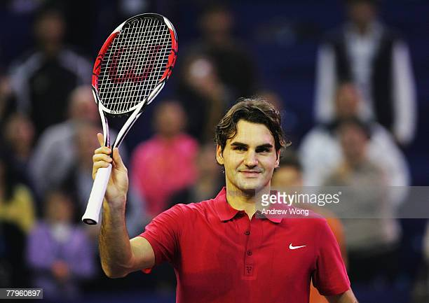Roger Federer of Switzerland celebrates following his semi-final win over Rafael Nadal of Spain in the Tennis Masters Cup at Qi Zhong Stadium on...