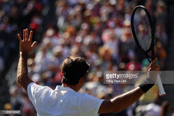 Roger Federer of Switzerland celebrates his men's singles fourth round match victory against Kyle Edmund of Great Britain on Day 10 of the BNP...