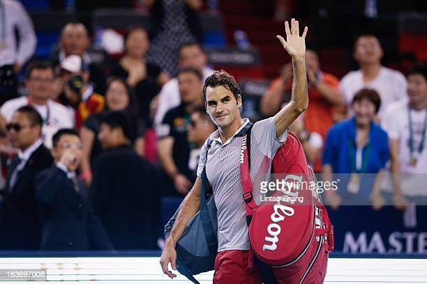 Roger Federer of Switzerland celebrates his win against Andreas Seppi of Italy during day three of the Shanghai Rolex Masters at the Qi Zhong Tennis...