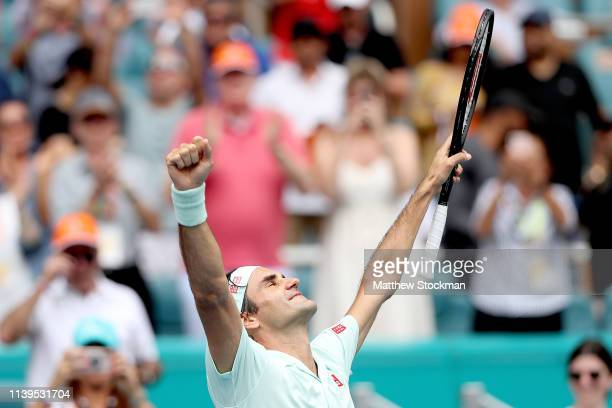 Roger Federer of Switzerland celebrates his win against John Isner during the men's final of the Miami Open Presented by Itau at Hard Rock Stadium...