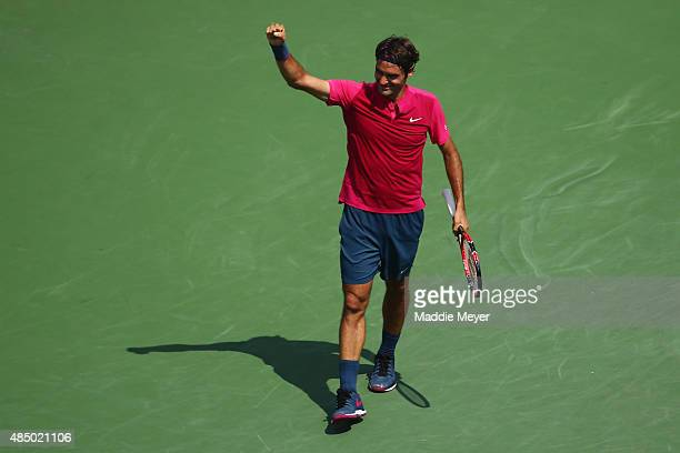 Roger Federer of Switzerland celebrates his win over Novak Djokovic of Serbia during the final round on Day 9 of the Western Southern Open at the...