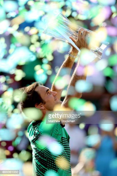 Roger Federer of Switzerland celebrates his win over Stan Wawrinka of Switzerland during the men's final of the BNP Paribas Open at the Indian Wells...