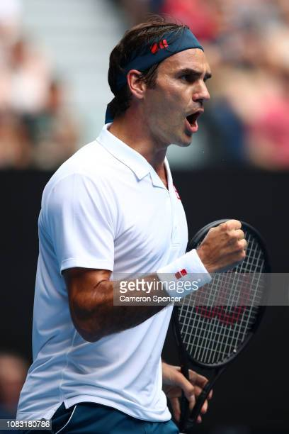 Roger Federer of Switzerland celebrates in his second round match against Daniel Evans of Great Britain during day three of the 2019 Australian Open...