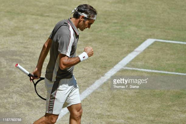 Roger Federer of Switzerland celebrates in the final match against David Goffin of Belgium during day 7 of the Noventi Open at Gerry Weber Stadium on...
