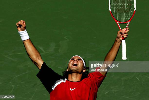 Roger Federer of Switzerland celebrates match point after defeating Rafael Nadal of Spain in the men's final during the NASDAQ-100 Open at the...