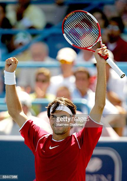 Roger Federer of Switzerland celebrates match point against Andy Roddick during the final of the Western & Southern Financial Group Masters on August...