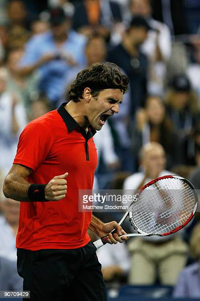Roger Federer of Switzerland celebrates match point against Novak Djokovic of Serbia during the Men's Singles Semifinal match on day fourteen of the...