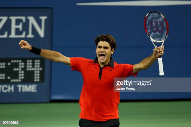 Roger Federer of Switzerland celebrates match point against Novak Djokovic of Serbia in the Men�s Singles Semifinal match on day fourteen of the 2009...