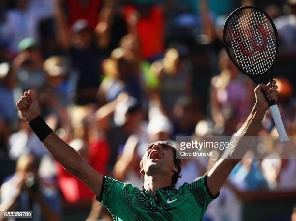 Roger Federer of Switzerland celebrates match point against Stanislas Wawrinka of Switzerland in the mens final during day fourteen of the BNP...