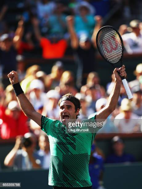 Roger Federer of Switzerland celebrates match point against Stanislas Wawrinka of Switzerland in the mens final during day fourteen of the BNP...