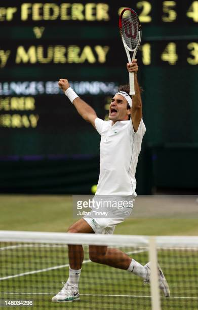 Roger Federer of Switzerland celebrates match point during his Gentlemen's Singles final match against Andy Murray of Great Britain on day thirteen...
