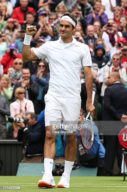 Roger Federer of Switzerland celebrates match point during his gentlemen's singles first round match against Victor Hanescu of Romania on day one of...