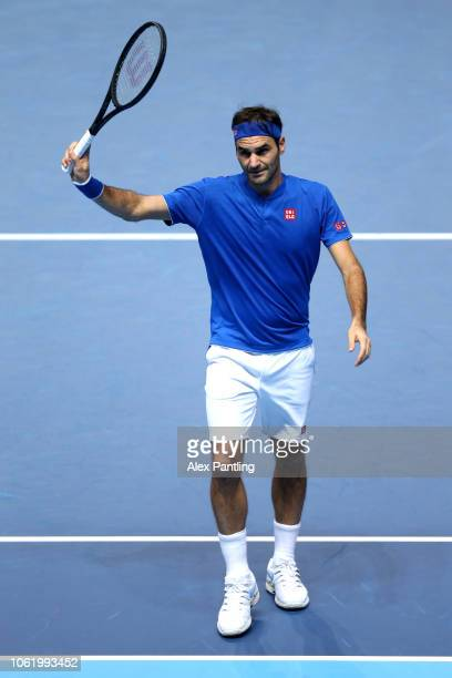 Roger Federer of Switzerland celebrates match point during his singles round robin match against Kevin Anderson of South Africa during Day Five of...