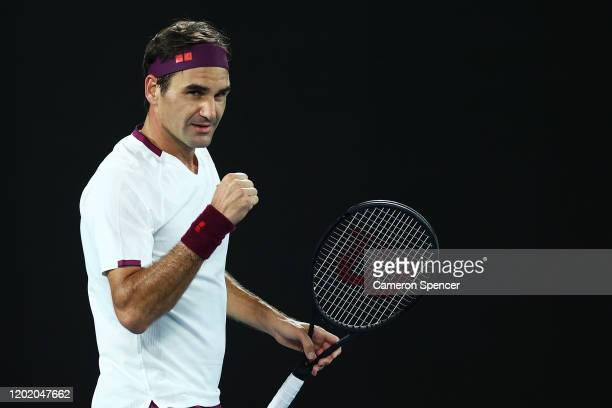 Roger Federer of Switzerland celebrates match point in his Men's Singles fourth round match against Marton Fucsovics of Hungary on day seven of the...