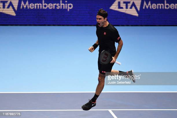 Roger Federer of Switzerland celebrates match point in his singles match against Novak Djokovic of Serbia during Day Five of the Nitto ATP Finals at...