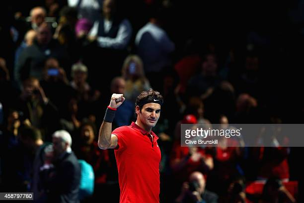 Roger Federer of Switzerland celebrates match point in the round robin singles match against Kei Nishikori of Japan on day three of the Barclays ATP...