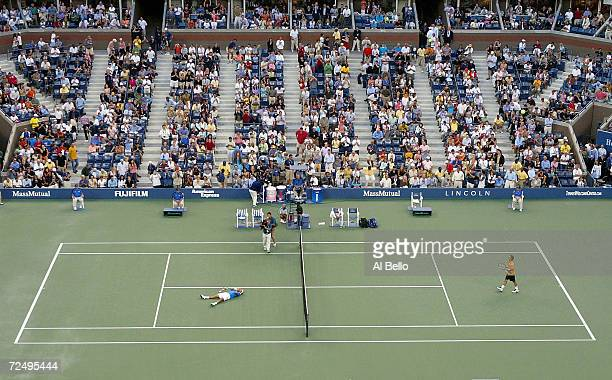 Roger Federer of Switzerland celebrates match point over Lleyton Hewitt of Australia with a score of 60 76 60 in the men's final during the US Open...