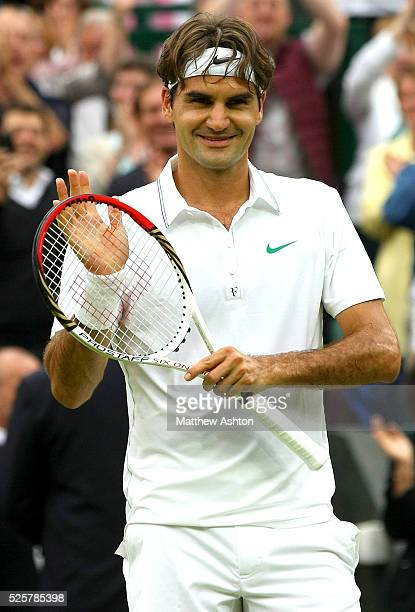Roger Federer of Switzerland celebrates on match point at Wimbledon, 2012