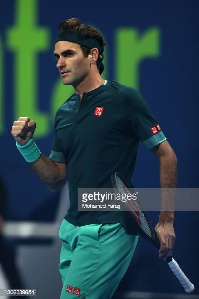 Roger Federer of Switzerland celebrates set point win in his match against Dan Evans of Great Britain on Day 3 of the Qatar ExxonMobil Open at...