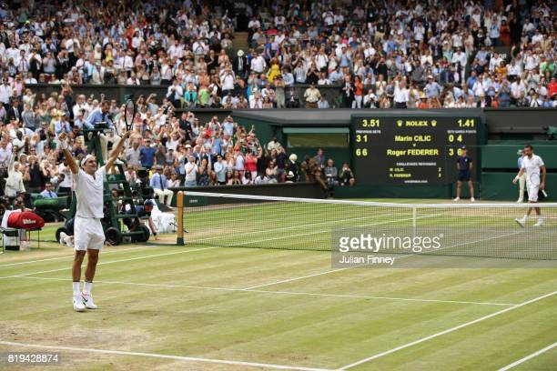Roger Federer of Switzerland celebrates victory after the Gentlemen's Singles final against Marin Cilic of Croatia on day thirteen of the Wimbledon...
