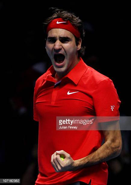 Roger Federer of Switzerland celebrates victory during his men's final match against Rafael Nadal of Spain during the ATP World Tour Finals at O2...