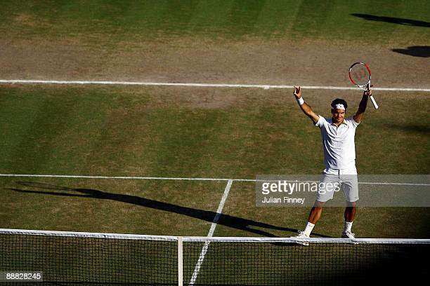 Roger Federer of Switzerland celebrates victory during the men's singles final match against Andy Roddick of USA on Day Thirteen of the Wimbledon...