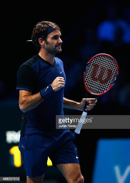 Roger Federer of Switzerland celebrates victory in his men's semi final against Stanislas Wawrinka of Switzerland on day seven of the Barclays ATP...