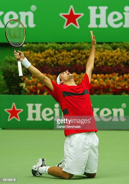 Roger Federer of Switzerland celebrates victory over Marat Safin of Russia during the Mens Singles Final during day fourteen of the Australian Open...