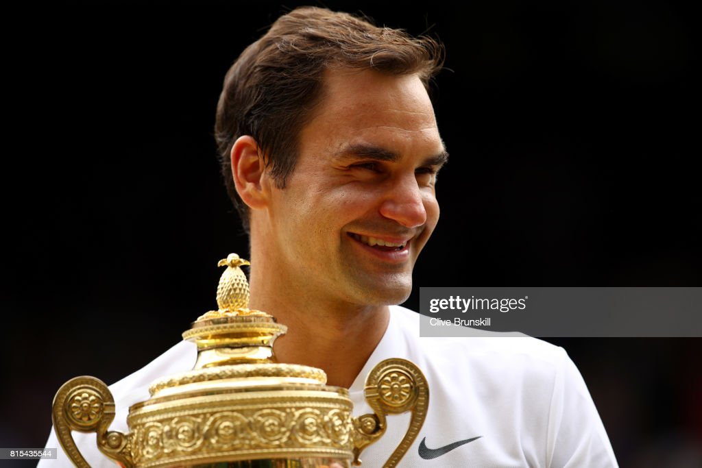 Roger Federer of Switzerland celebrates victory with the trophy after the Gentlemen's Singles final against Marin Cilic of Croatia on day thirteen of the Wimbledon Lawn Tennis Championships at the All England Lawn Tennis and Croquet Club at Wimbledon on July 16, 2017 in London, England.