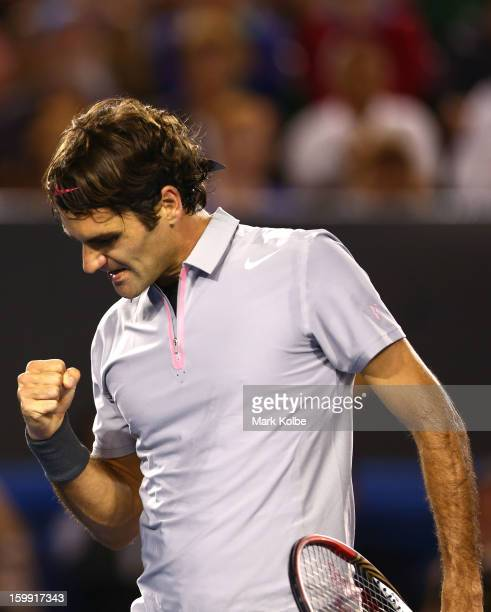 Roger Federer of Switzerland celebrates winning a break point in his Quarterfinal match against JoWilfred Tsonga of France during day ten of the 2013...