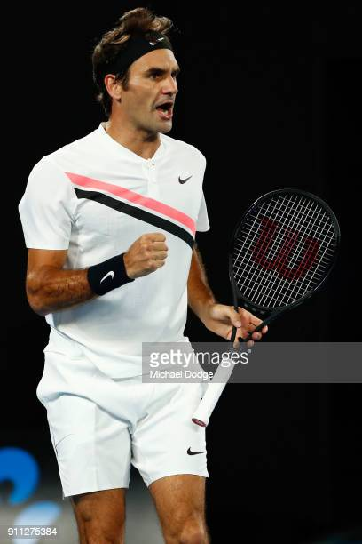 Roger Federer of Switzerland celebrates winning a point in his men's singles final match against Marin Cilic of Croatia on day 14 of the 2018...