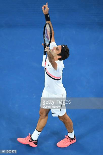 Roger Federer of Switzerland celebrates winning championship point in his men's singles final match against Marin Cilic of Croatia on day 14 of the...