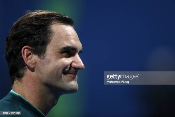 Roger Federer of Switzerland celebrates winning his match against Dan Evans of Great Britain on Day 3 of the Qatar ExxonMobil Open at Khalifa...
