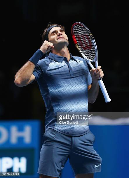 Roger Federer of Switzerland celebrates winning his men's singles match against Juan Martin Del Potro of Argentina during day six of the Barclays ATP...