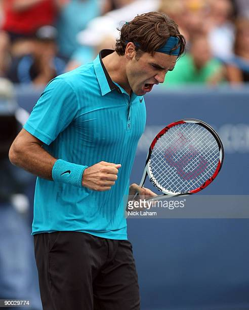 Roger Federer of Switzerland celebrates winning match point against Novak Djokovic of Serbia in the Singles Final during day seven of the Western...