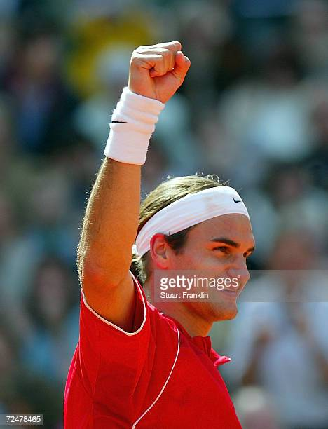 Roger Federer of Switzerland celebrates winning the final match against Guillermo Coria of Argentina at The ATP Tennis Masters Series Hamburg at the...