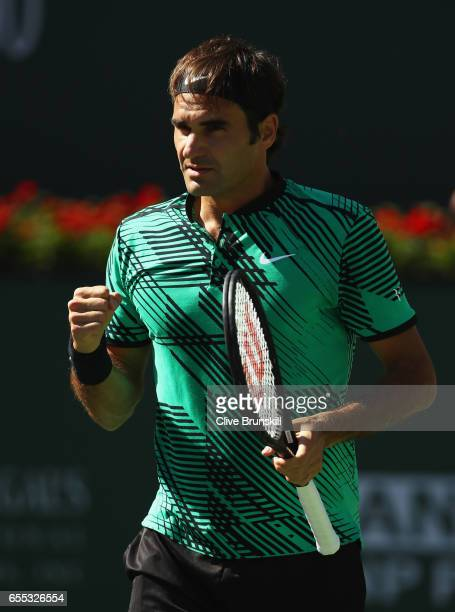 Roger Federer of Switzerland celebrates winning the first set against Stanislas Wawrinka of Switzerland in the mens final during day fourteen of the...