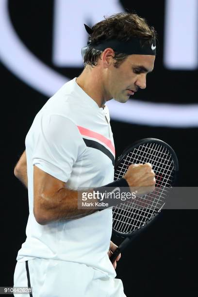 Roger Federer of Switzerland celebrates winning the first set in his semifinal match against Hyeon Chung of South Korea on day 12 of the 2018...