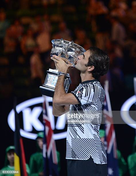 Roger Federer of Switzerland celebrates with the championship trophy after Australian Open 2017 men's final match against Rafael Nadal of Spain at...