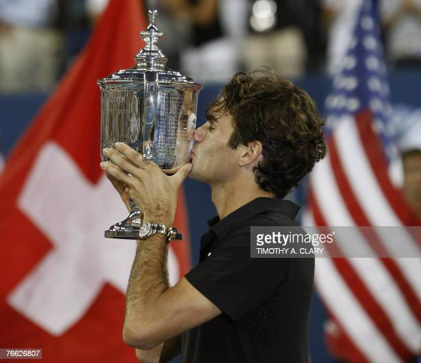 Roger Federer of Switzerland celebrates with the trophy after defeating Novak Djokovic of Serbia by a score of 76 76 64 to win the US Open men's...