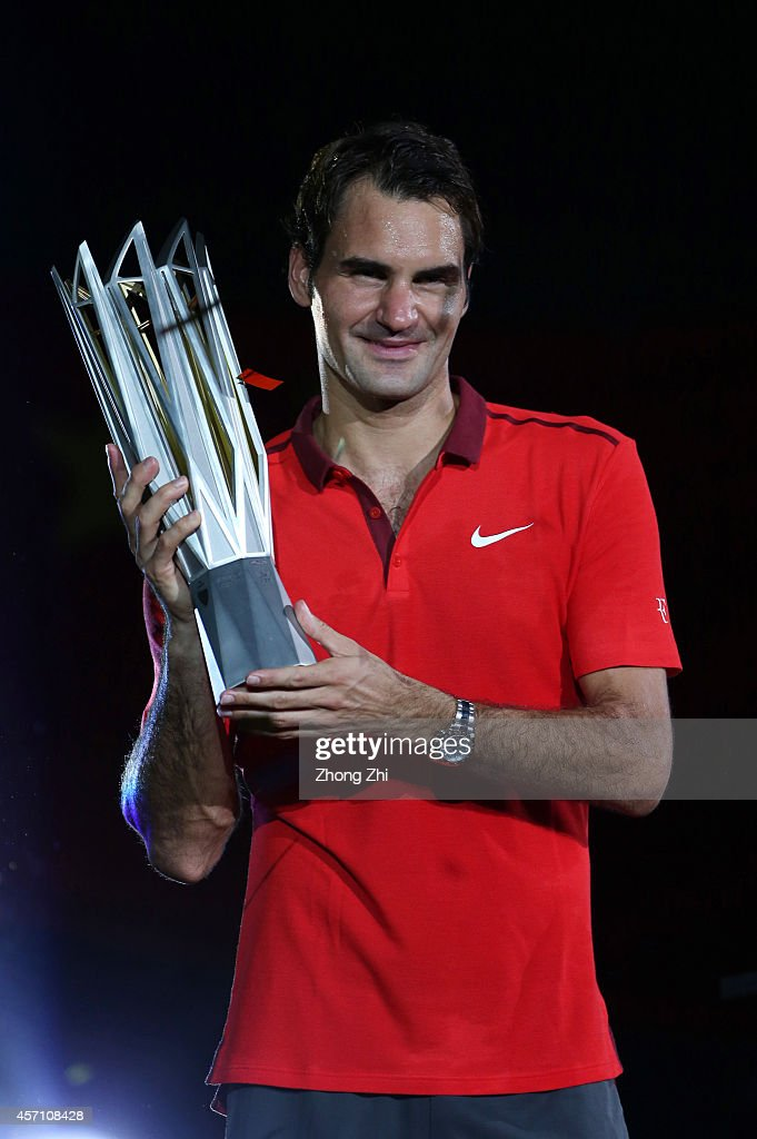 Roger Federer of Switzerland celebrates with the trophy after winning the final match against Gilles Simon of France during the day 8 of the Shanghai Rolex Masters at the Qi Zhong Tennis Center on October 12, 2014 in Shanghai, China.
