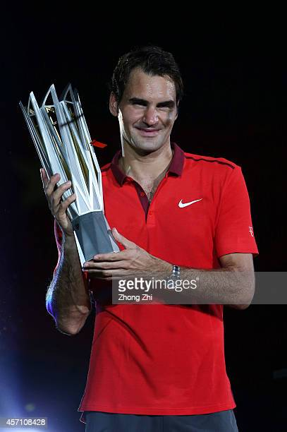 Roger Federer of Switzerland celebrates with the trophy after winning the final match against Gilles Simon of France during the day 8 of the Shanghai...