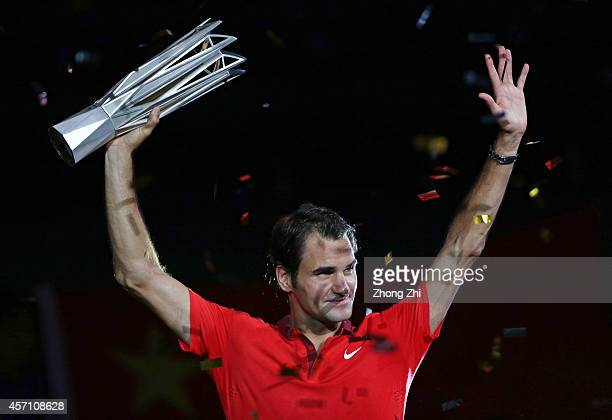 Roger Federer of Switzerland celebrates with the trophy after winning the final against Gilles Simon of France during the day 8 of the Shanghai Rolex...