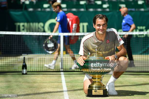 Roger Federer of Switzerland celebrates with the winners cup after winning the final match against David Goffin of Belgium during day 7 of the...