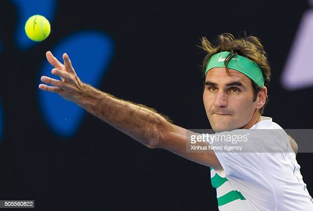Roger Federer of Switzerland competes during the firstround match of men's singles of Australian Open Tennis Championships against Nikoloz...