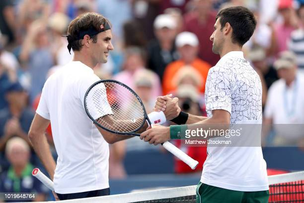 Roger Federer of Switzerland congratulates Novak Djokovic of Serbia after their match during the men's final of the Western Southern Open at Lindner...