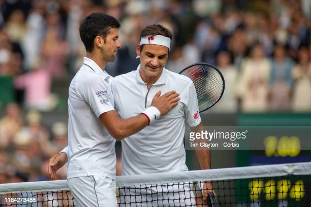 Roger Federer of Switzerland congratulates Novak Djokovic of Serbia at the net after his victory during the Men's Singles Final on Centre Court...